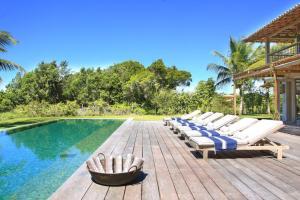 Capa aluguel de casas de luxo Villa21 em Trancoso Bahia