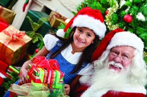 Christmas portrait of a girl with Santa Claus smiling inside