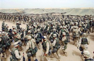 CAMP SHOUP, KUWAIT: TO GO WITH IRAQ-ANNIVERSARY PACKAGES (FILES) US Marines from the 2nd battalion/8 MAR, prepare themselves after receiving orders to cross the Iraqi border at Camp Shoup, northern Kuwait, 20 March 2003. Four years after a US-led invasion billed as a bid to disarm Iraq and create a democratic pro-Western enclave in the Middle East, commanders are in fact pouring 25,000 reinforcements into Baghdad to quell Sunni-Shiite fighting, the bloodiest element of the conflict and one which even the Pentagon admits now amounts to civil war. AFP PHOTO/Eric FEFERBERG (Photo credit should read ERIC FEFERBERG/AFP/Getty Images)