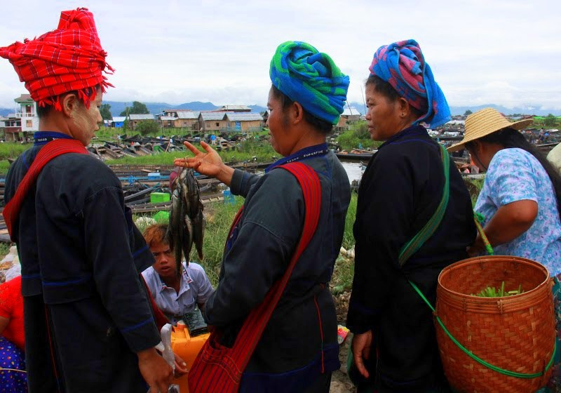 Shan women buying fish at lake inle weekly markets