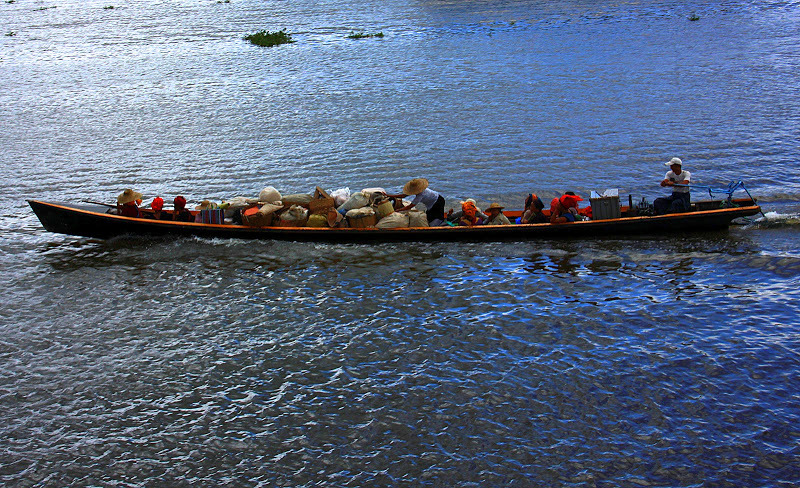 Women going home to Samkar by boat on lake inle