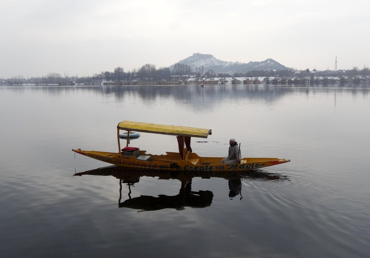 Kashmir in winter shows off gondolas on semi frozen dal lake