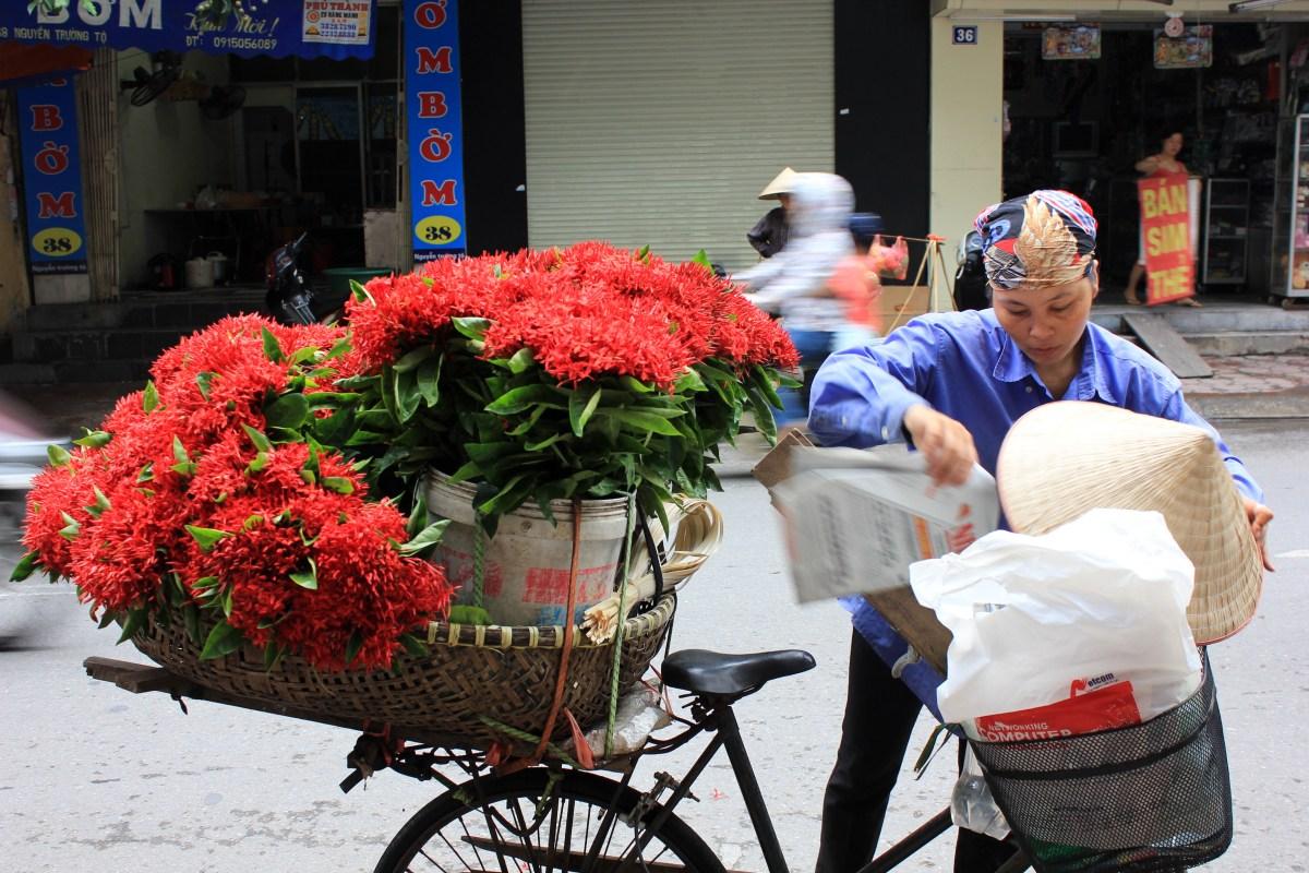 a flower seller in hanoi