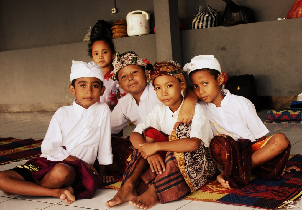 Little Hindu boys wearing traditional costume in Bali