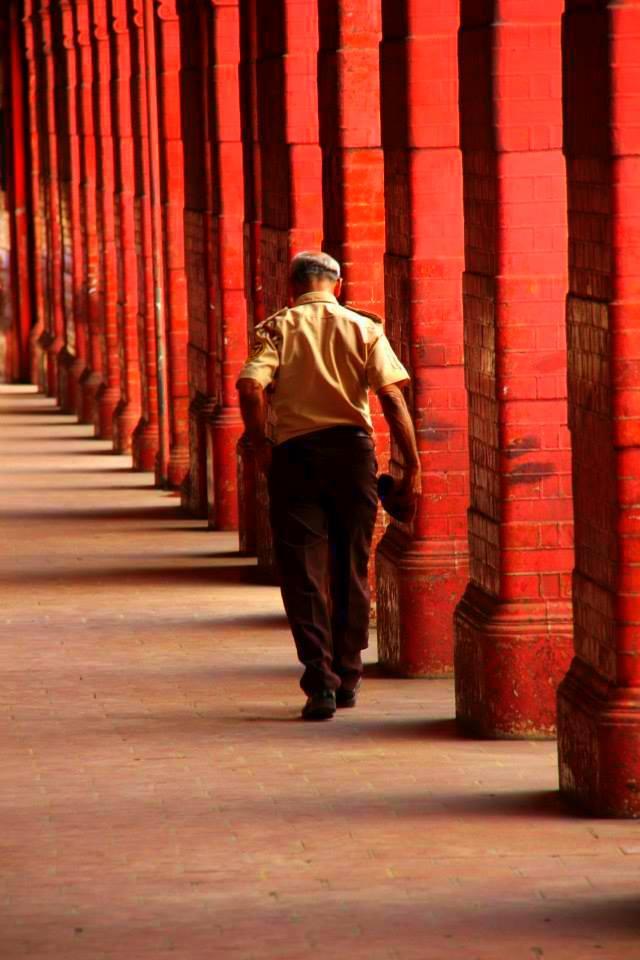 A man walking down a corridor at Colombo Fort