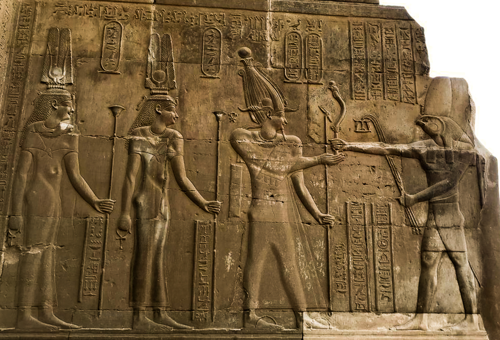 Wall Relief of Cleopatra III, Cleopatra II and Ptolemy VIII before Horus. Kom Ombo Temple Egypt