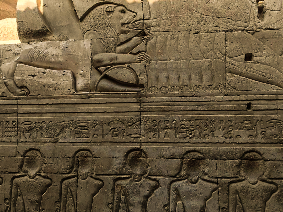 The relief with the running lion biting the slave's hand Kom Ombo Temple Egypt.