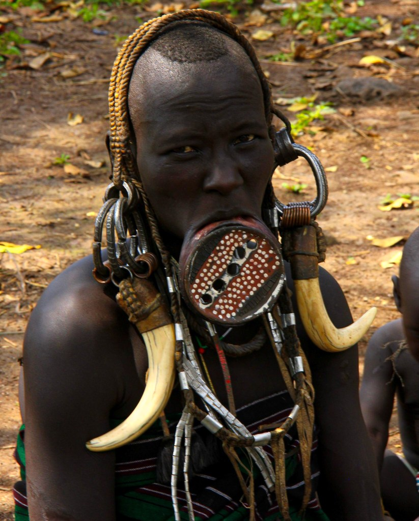 A lower omo valley Mursi woman adorned with a lip plate in Ethiopia's Omo Valley