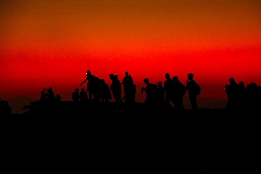 Travelers at Erta Ale volcano crater in Danakil Depression