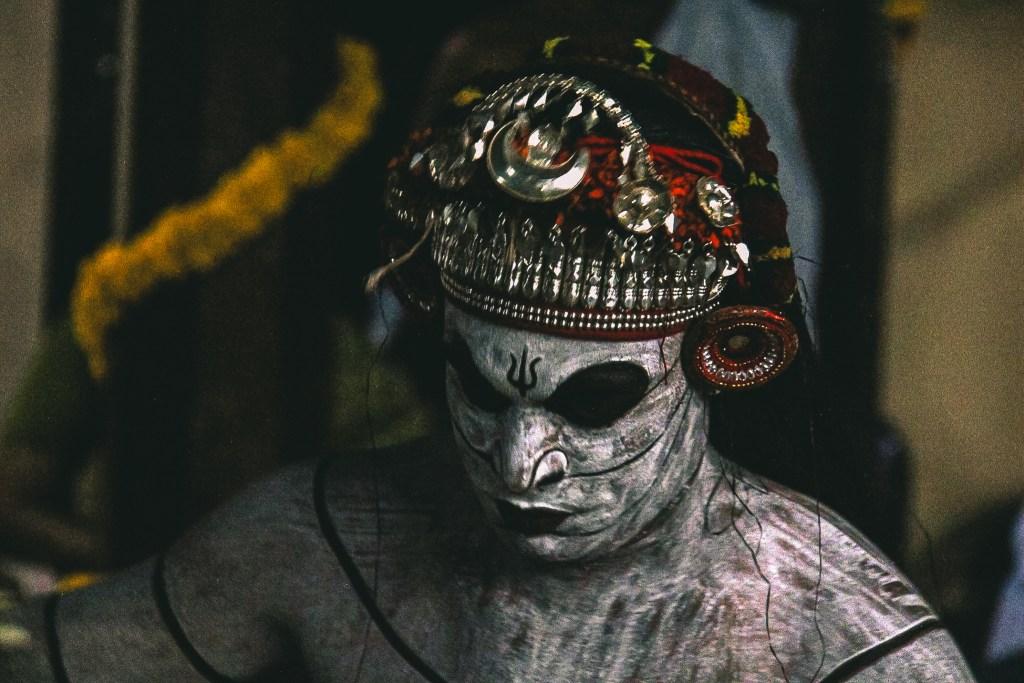 A theyyam performer getting ready