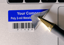 metalized matte silver asset tag on laptop