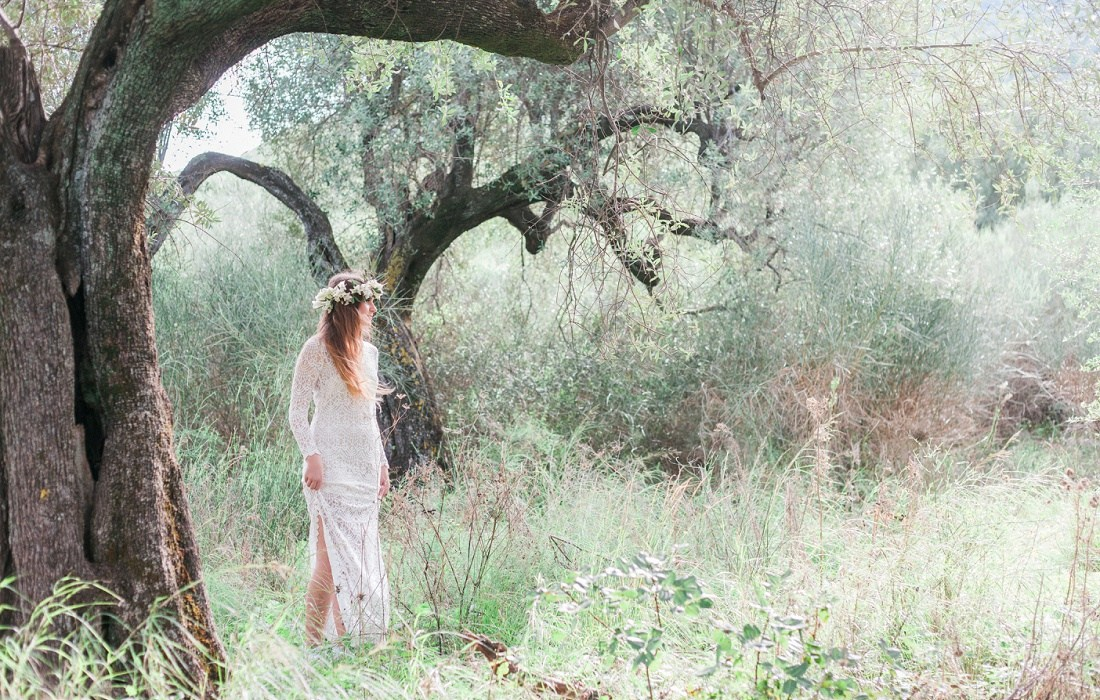 Maxeen Kim - Wedding Photographer in Greece and the UK - bride standing in Greek olive grove