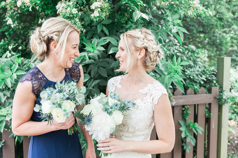 Bride and Bridesmaid Laughing in the Garden