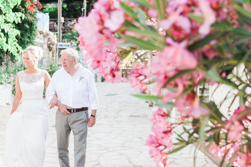 Bride and Her Father Walking through Agios Nikitas Village