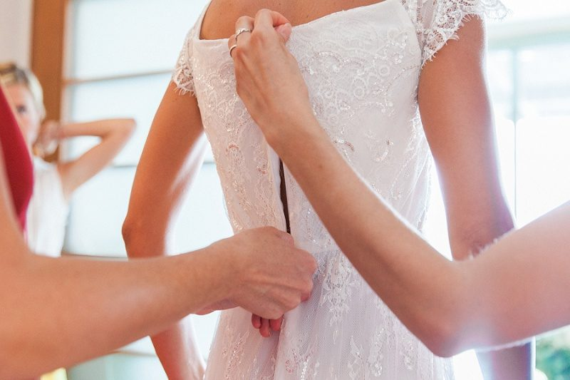 Bridesmaids Helping Bride with Her Bohemian Dress