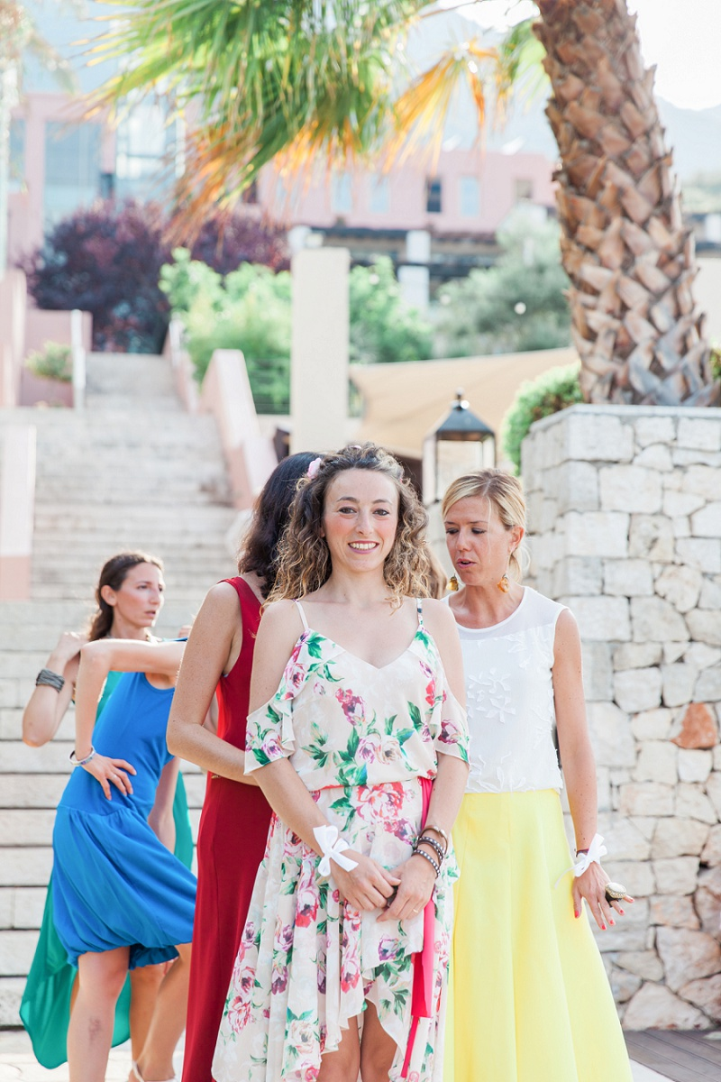 Bridesmaids in Multicoloured Dresses Standing at the Top of the Aisle