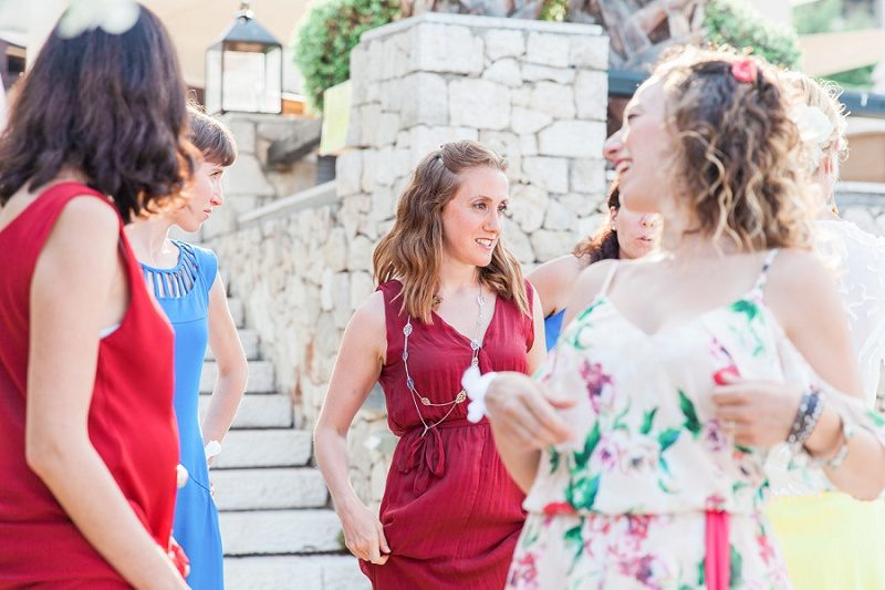 Bridesmaids in Multicoloured Dresses Waiting to Walk Down the Aisle