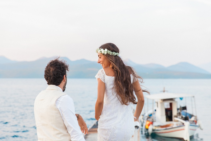Bride and Groom With A Traditional Greek Boat at Ionian Blue Hotel