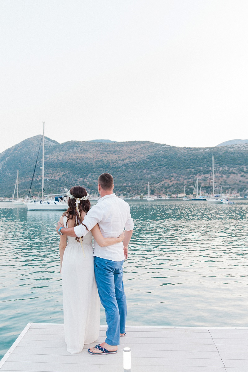 Bride and Groom on the Jetty at Seaside Restaurant in Geni
