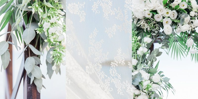 Close Up Details Of the Lace and Flowers On the Wedding Arch