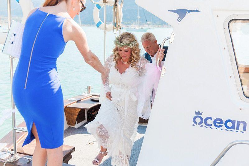 Bride Arriving By Boat At Her Vintage Wedding at SeaSide