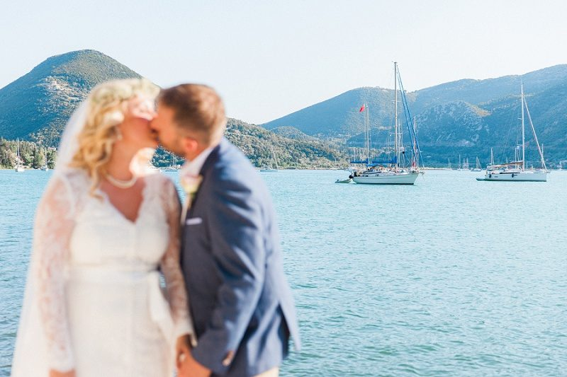Couple Kissing At their Vintage Wedding at SeaSide Restaurant
