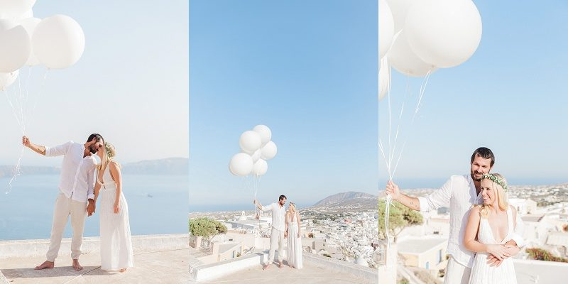 Bride and Groom with Giant White Balloons in Santorini