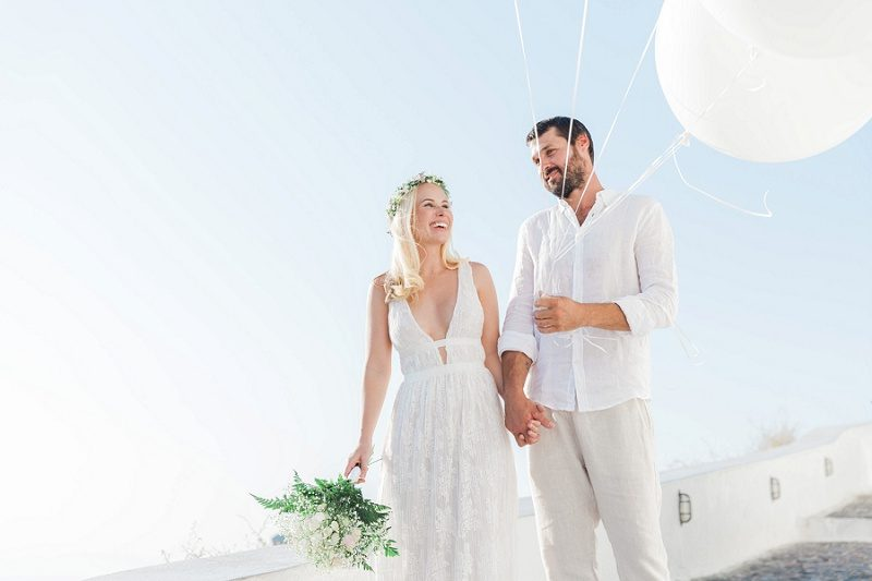 Newlyweds in Fira With Giant White Balloons
