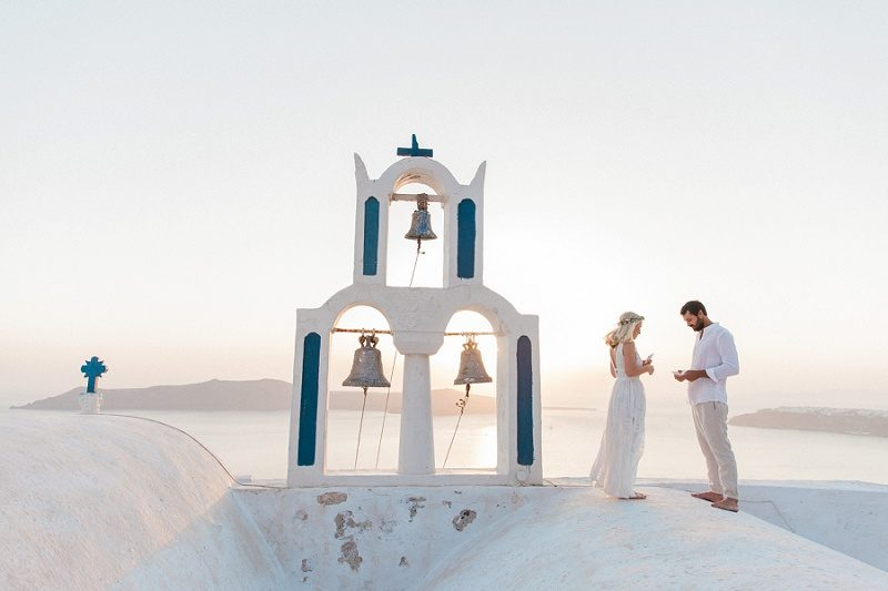 Couple Exchanging Vows On a Church Roof in Santorini