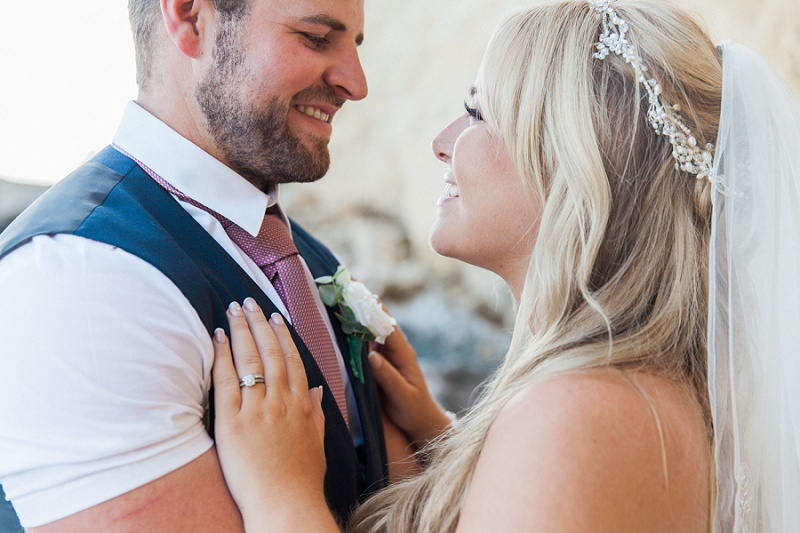 Close up of the groom and bride smiling lovingly at each other