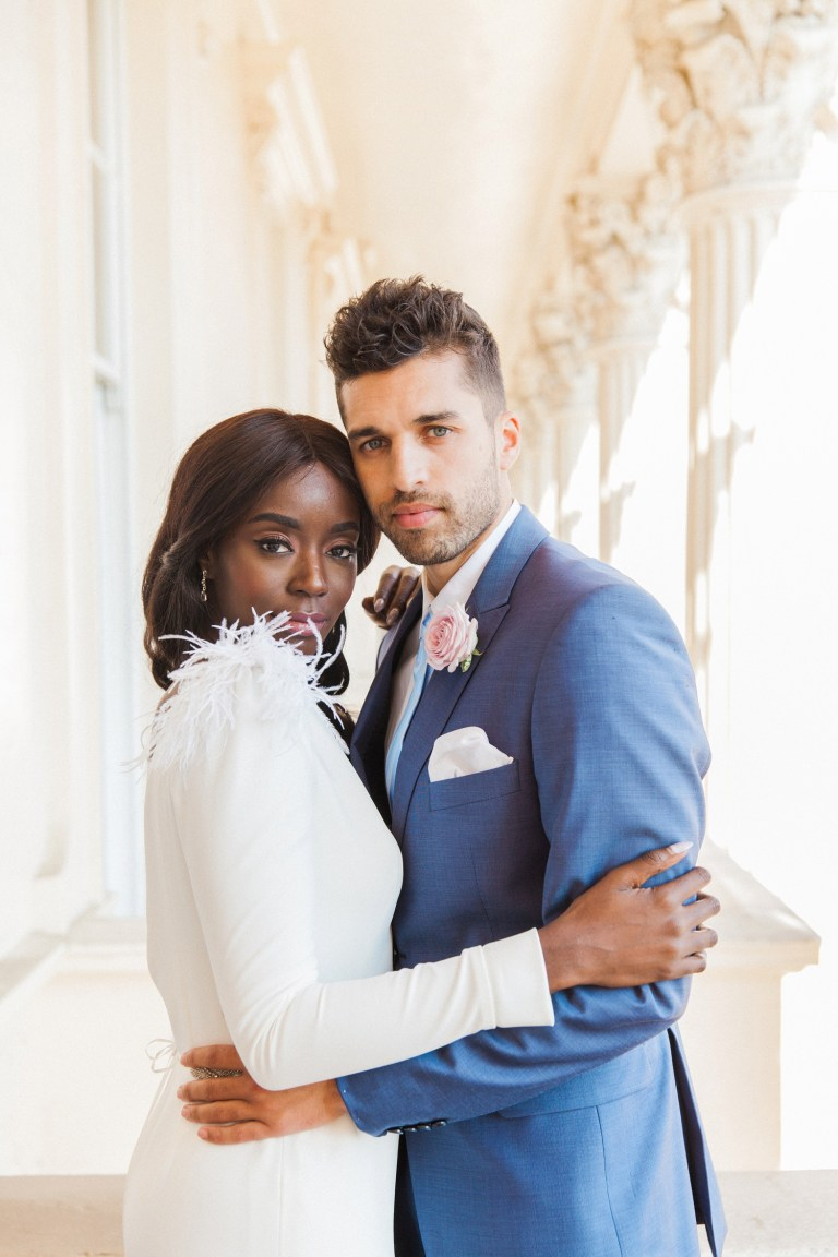 Portrait of a black bride and a white groom on the balcony during their 10-11 Carlton House Terrace wedding in London