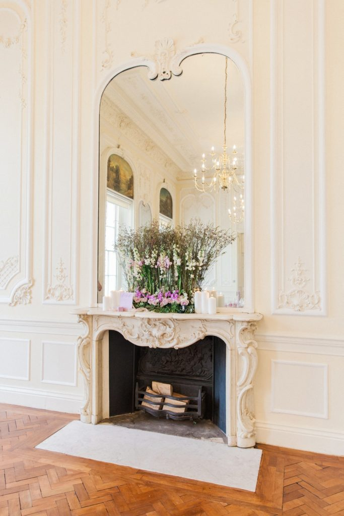 Fire place at 10-11 Carlton House Terrace decorated with lilac and white flowers for a wedding