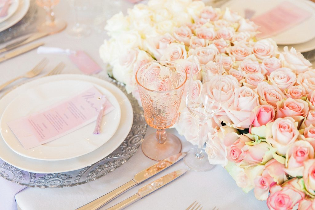 Wedding table setting with pink and white David Austin roses styled by Pearline Events