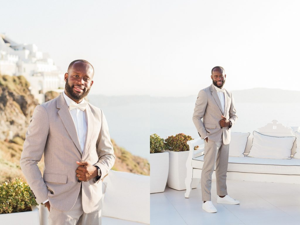 Groom Portraits showing his wedding outfit against a backdrop of Santorini cliffs and white houses