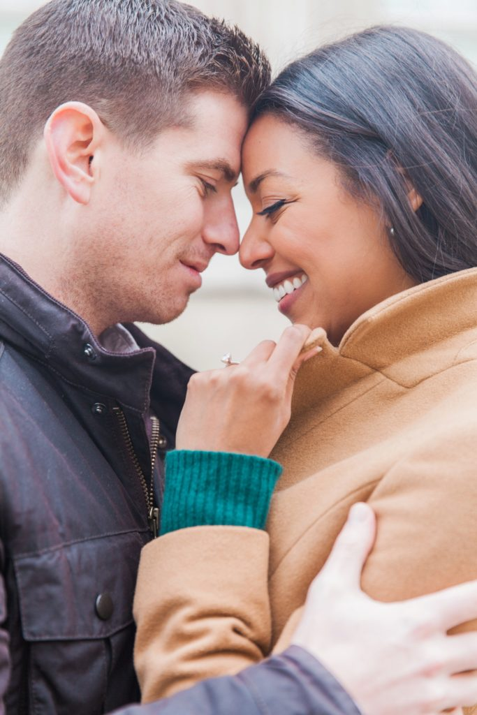 Portrait of a smiling couple nose to nose during their engagement photo shoot