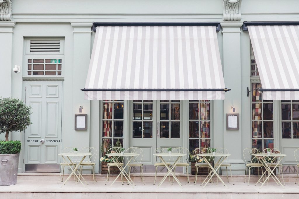 Sage green tables outside the Charlotte Street Hotel in London