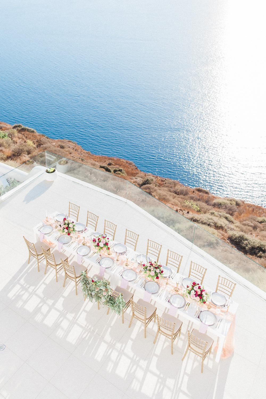 Wedding reception table on a balcony at Dana Villas Santorini