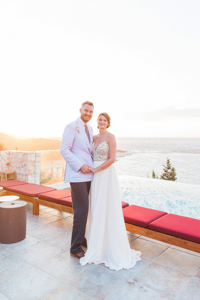 Bride and groom on the patio during their Emelisse Hotel wedding on Kefalonia in Greece