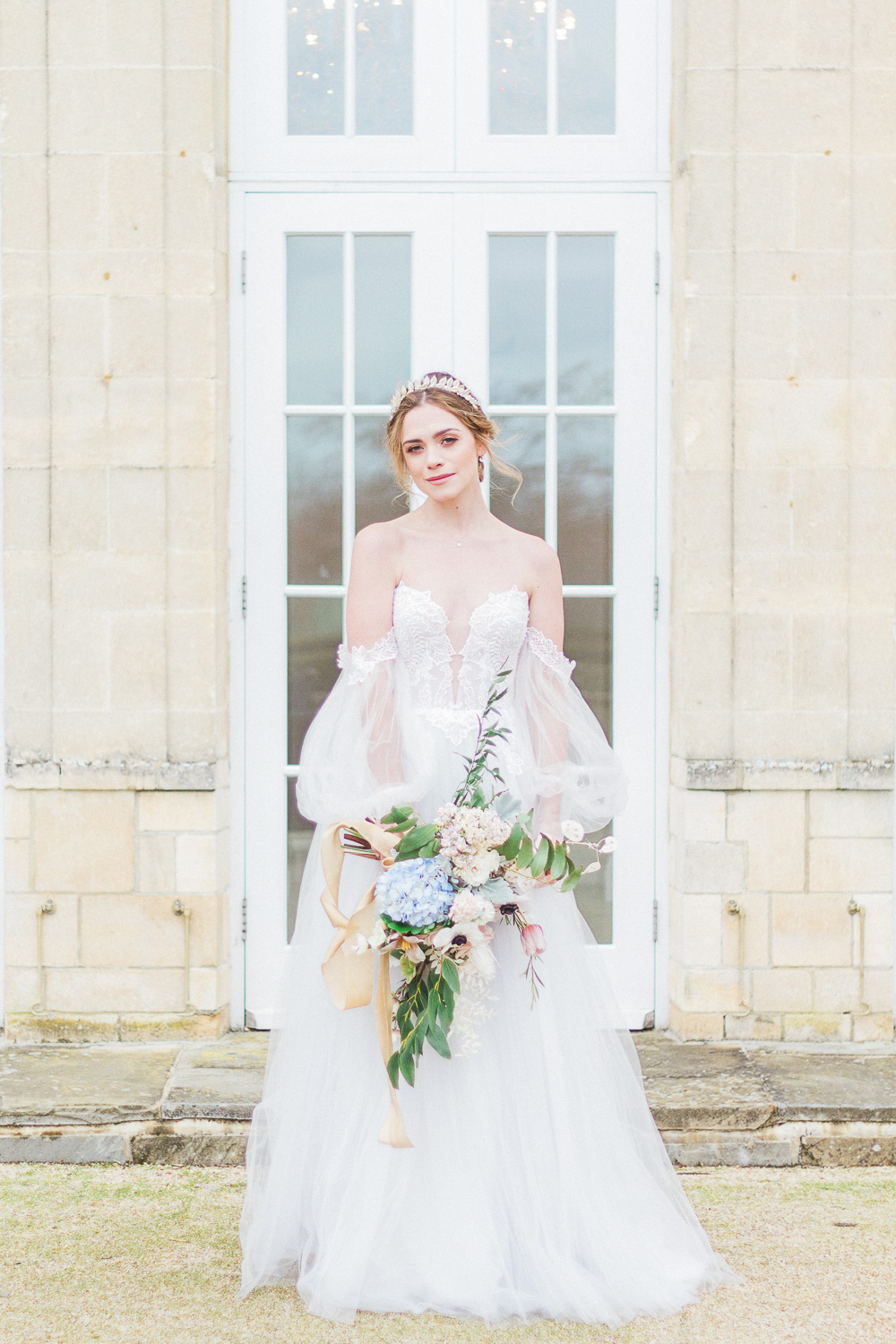 Bride with a spring bouquet at Froyle Park wedding venue in the UK