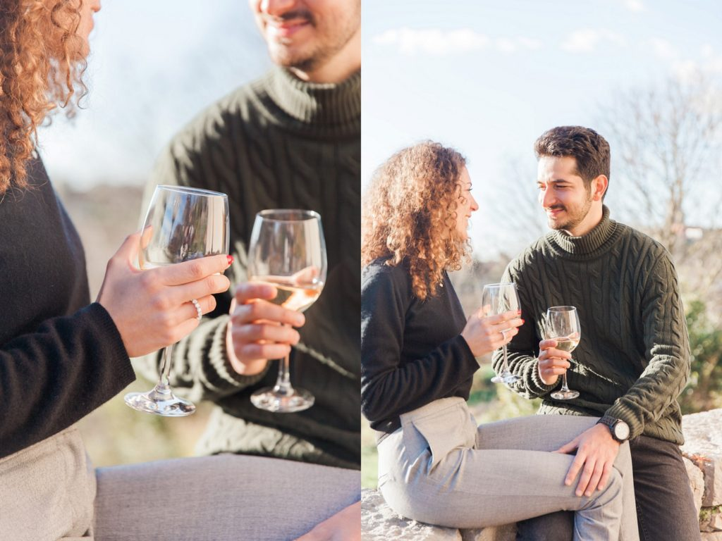 Couple share a glass of wine during their Italian countryside couple photography session