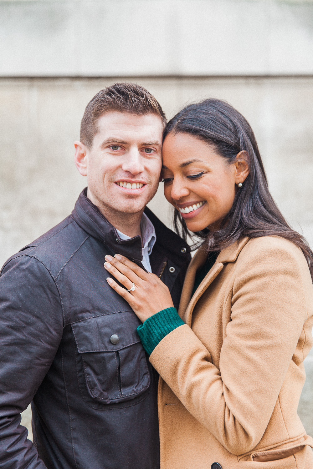 Couple hug during their autumn engagement shoot in London