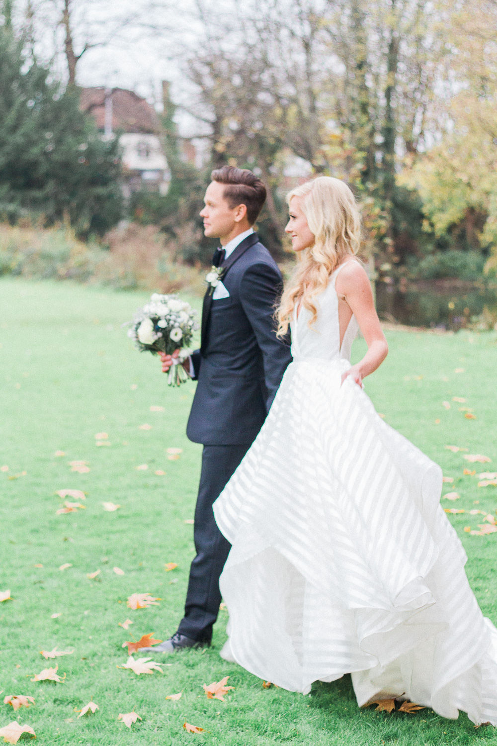 Bride and groom in the grounds of Morden Hall wedding venue in London