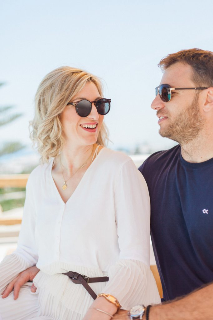 Couple smile at each other during their shoot at Artemoulas Studios Mykonos