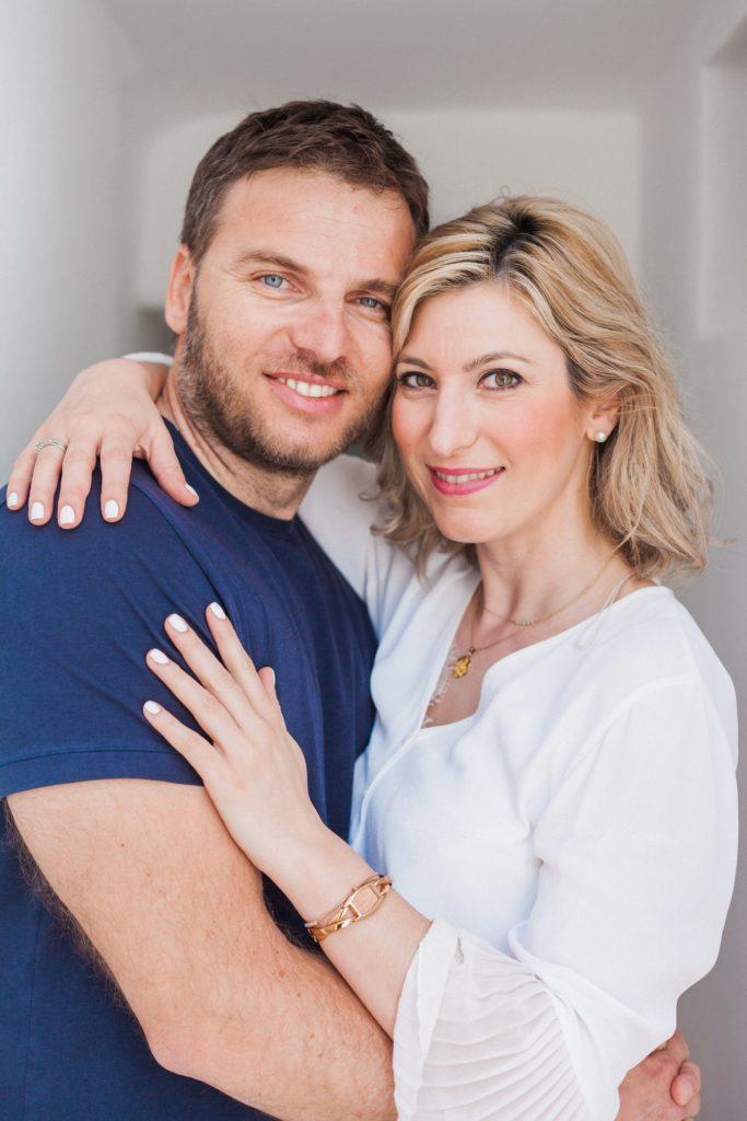 Portrait of a Greek couple in a whitewashed corridor at Artemoulas Studios Mykonos