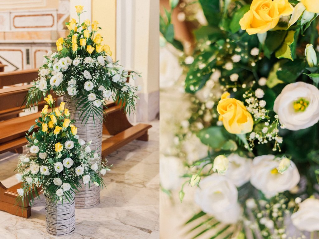 White and yellow roses and decor in a traditional Italian church in the village of Chieuti in Apulia