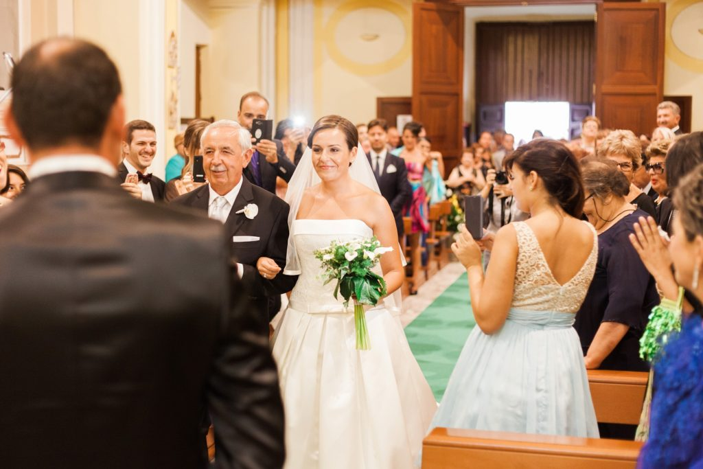 Bride walks down the aisle in the Italian village of Chieuti in Apulia