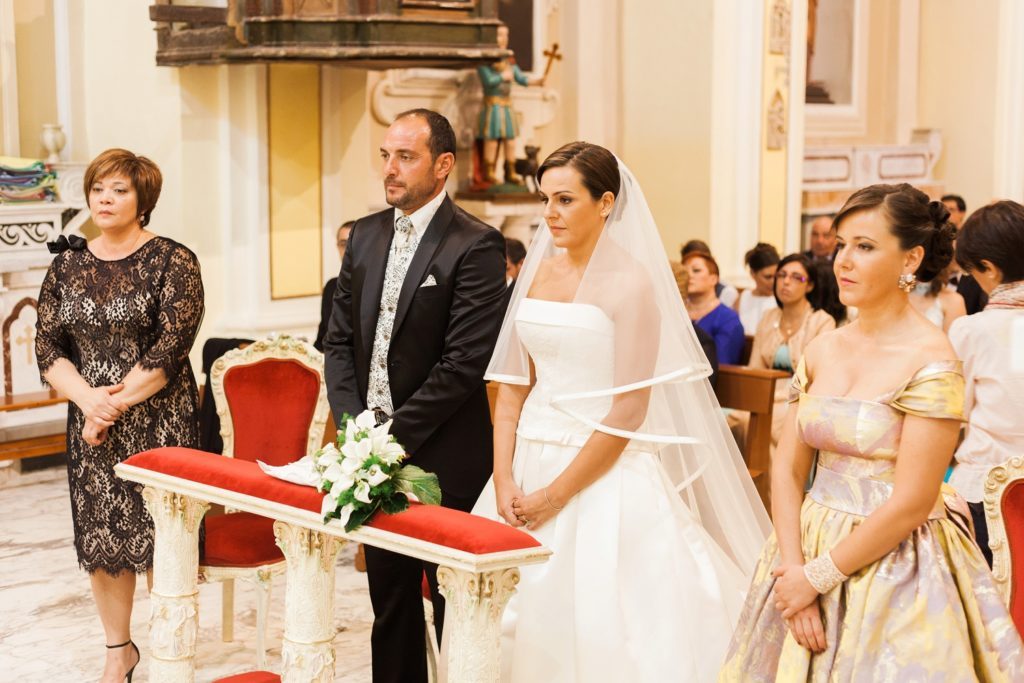Italian couples and their witnesses in a traditional Italian church in Apulia