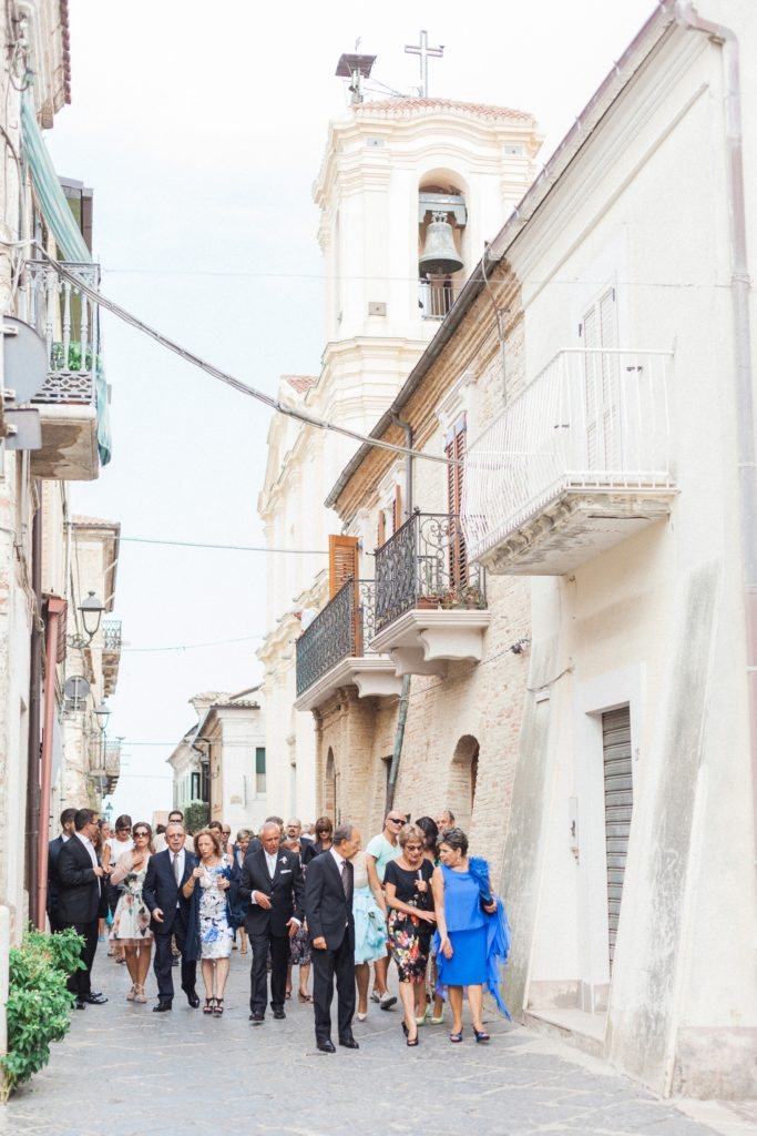 Guests outside the church in the Italian village of Chieuti in Apulia