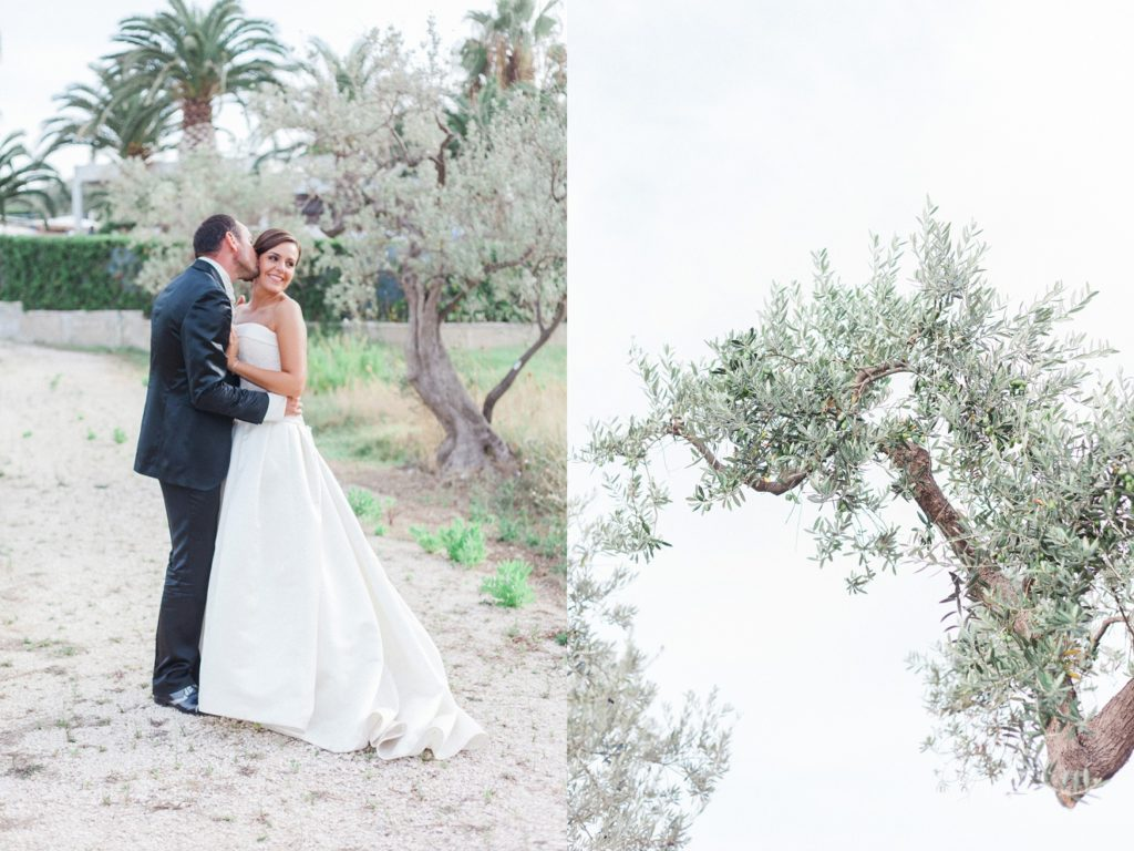 Bride and groom stand together in the gardens of the Convivium Hotel in Vasto during their Abruzzo wedding