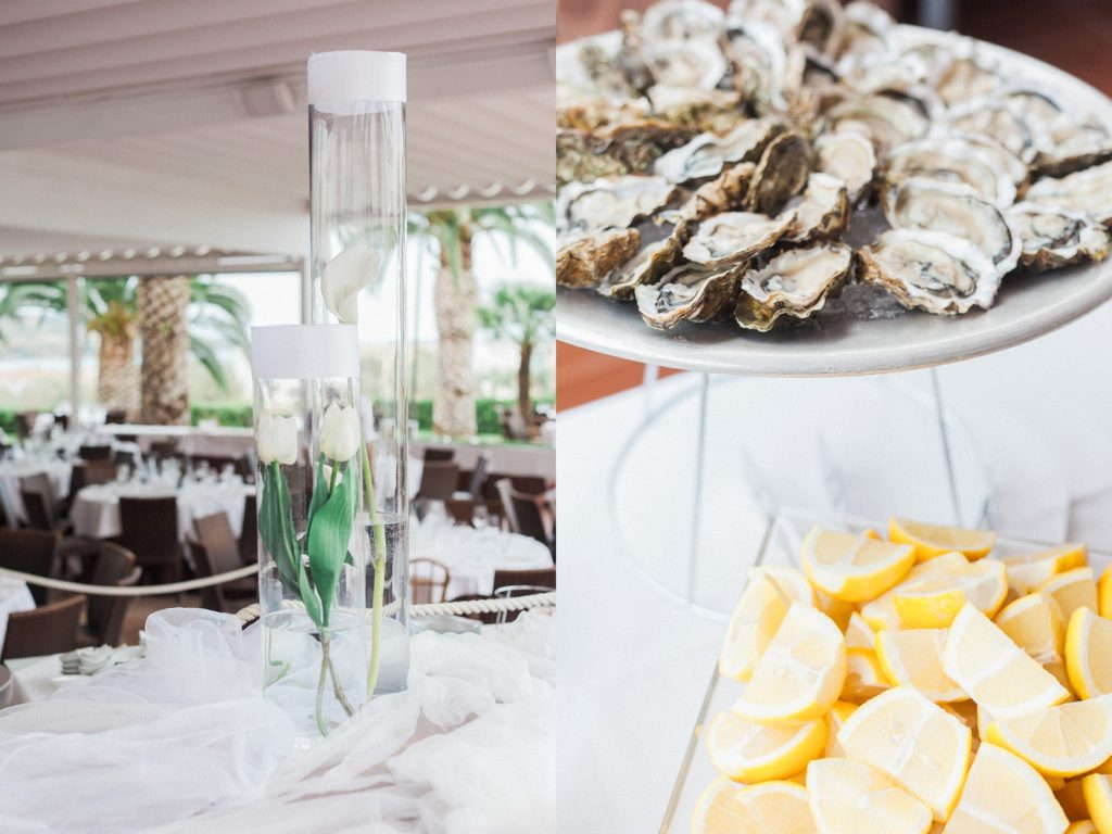 White tulips and lilies in vases and oysters with lemon at a wedding at the Convivium Hotel in Vasto